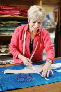 Jenny Edwards-Moss Cutting-Out a Jacket in her shop in Stow-on-the-Wold